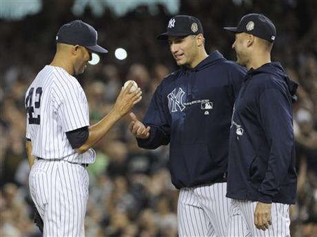 Rivera walks off the mound at Yankee Stadium for the last time, given the hook by fellow Yankee icons Andy Pettitte and Derek Jeter.
