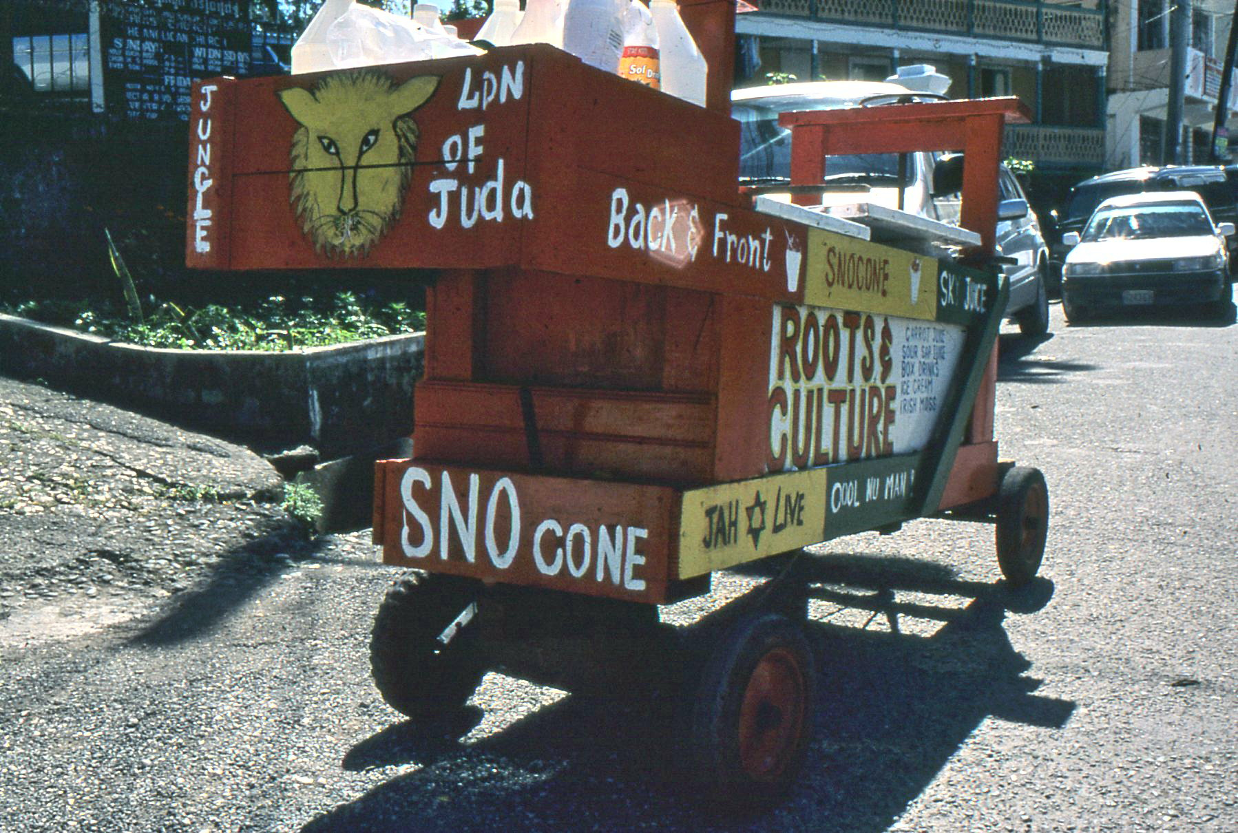 "This ""Lion of Juda"" [sic] cart patrols the market in Port Antonio, Jamaica. ""Jah Live,"" yes indeed."