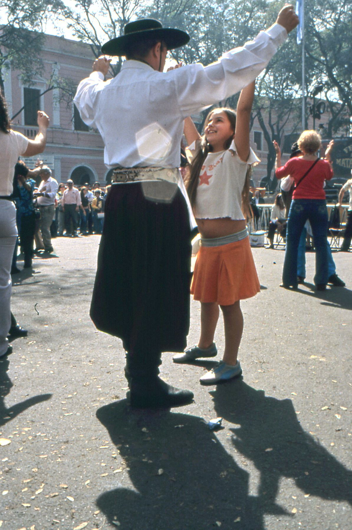 Aside from the sarteja, the most symbolic part of the Feria is the street dancing. This young girl knew all the steps, and was thrilled to be chosen as a gaucho's partner.