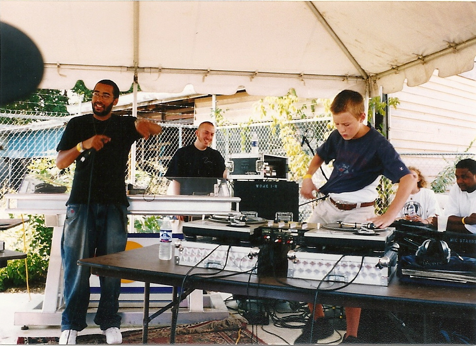 DJ X-plore slaps down the end of his battle performance at the annual Twin Cities Celebration of Hip Hop, 2003.