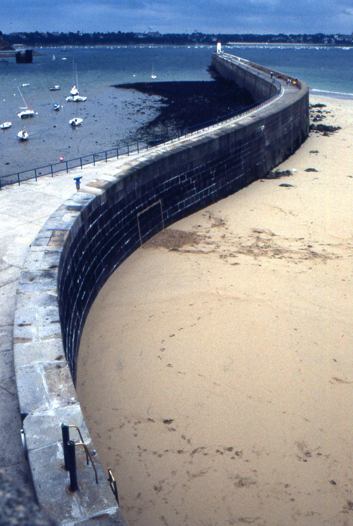 The delicate bend of St. Malo's sea wall protects swimmers from the rougher waters of the open Atlantic.