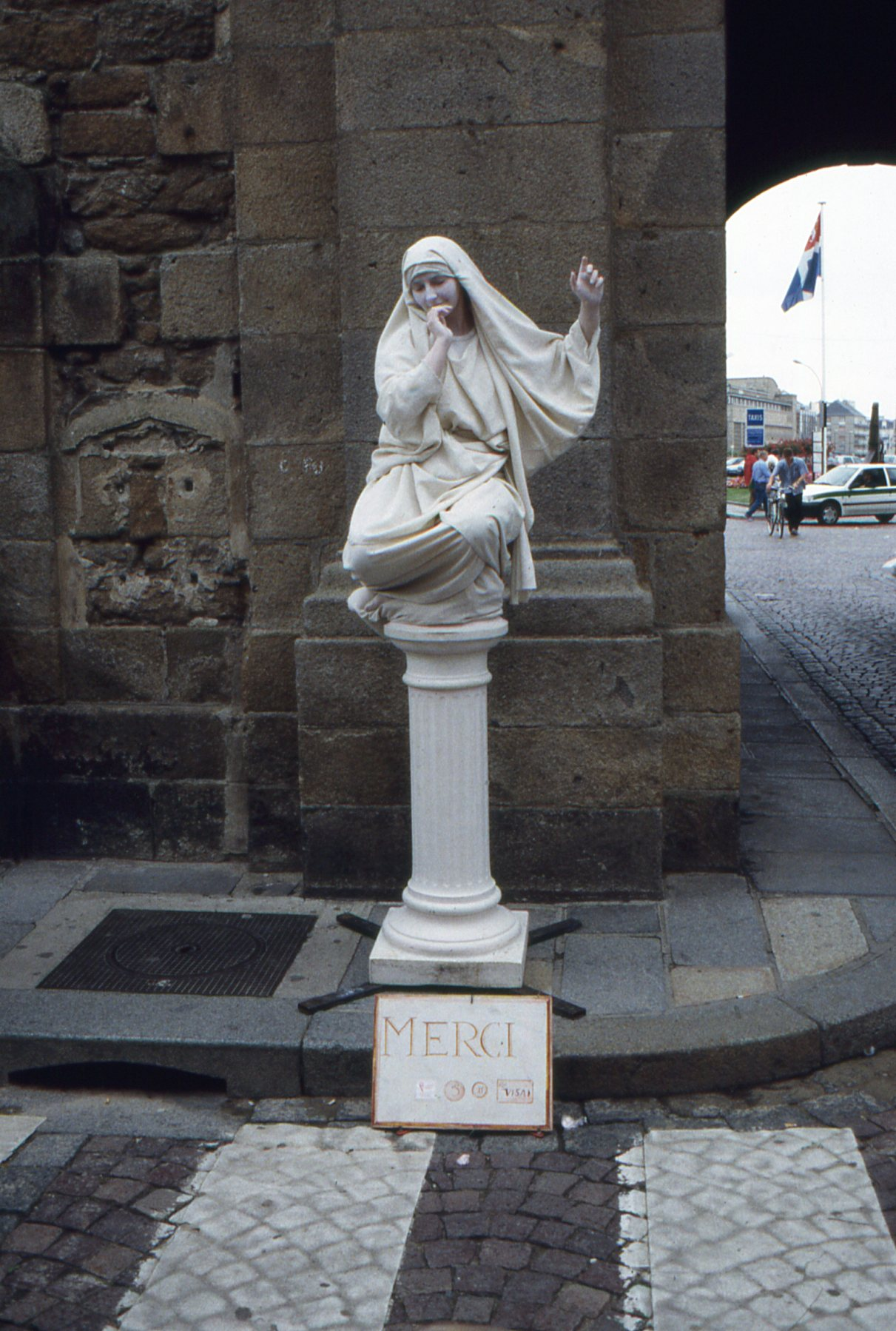 This street performer in St. Malo's main square poses quite convincingly as a marble statue and expects suitable compensation in return.