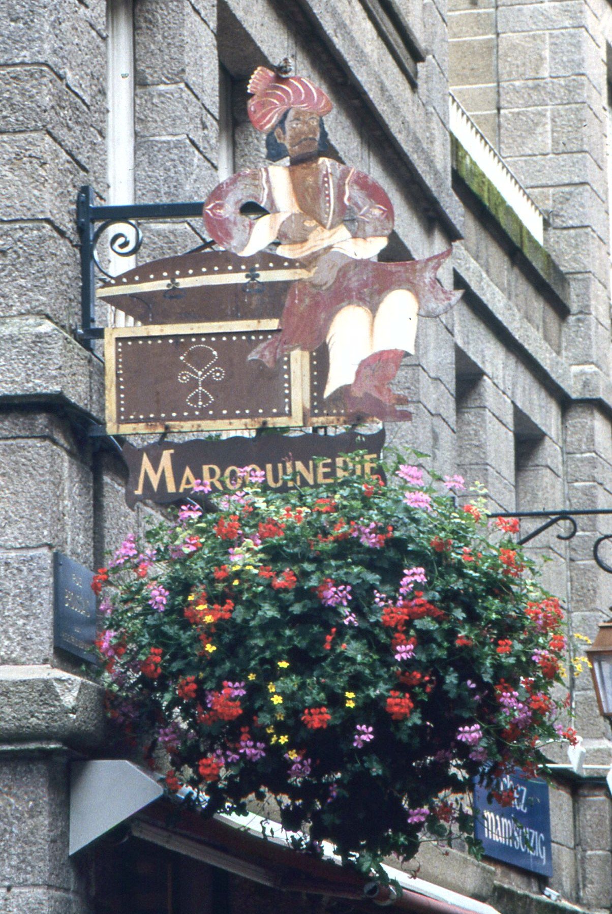 St. Malo's merchants pride themselves on elaborate shop signs, often embellished with floral arrangements.
