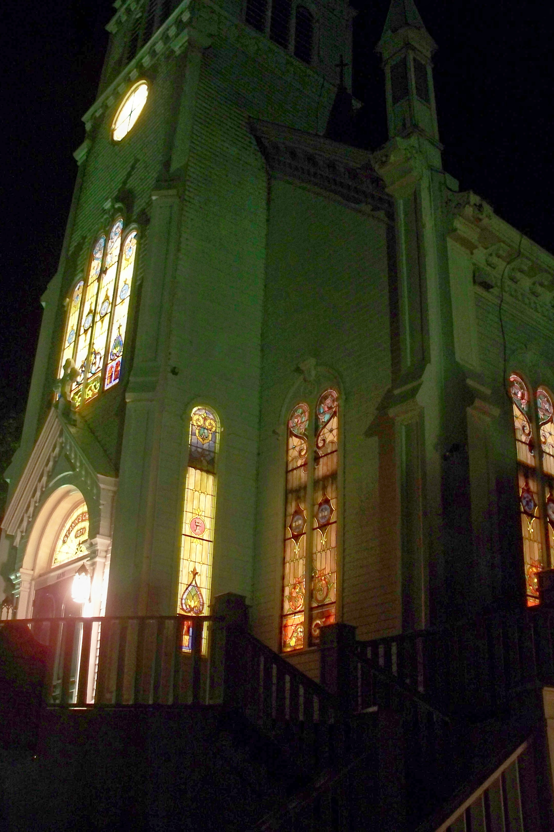 St. Anne's Church by night. The stained glass windows include an eye in a pyramid.