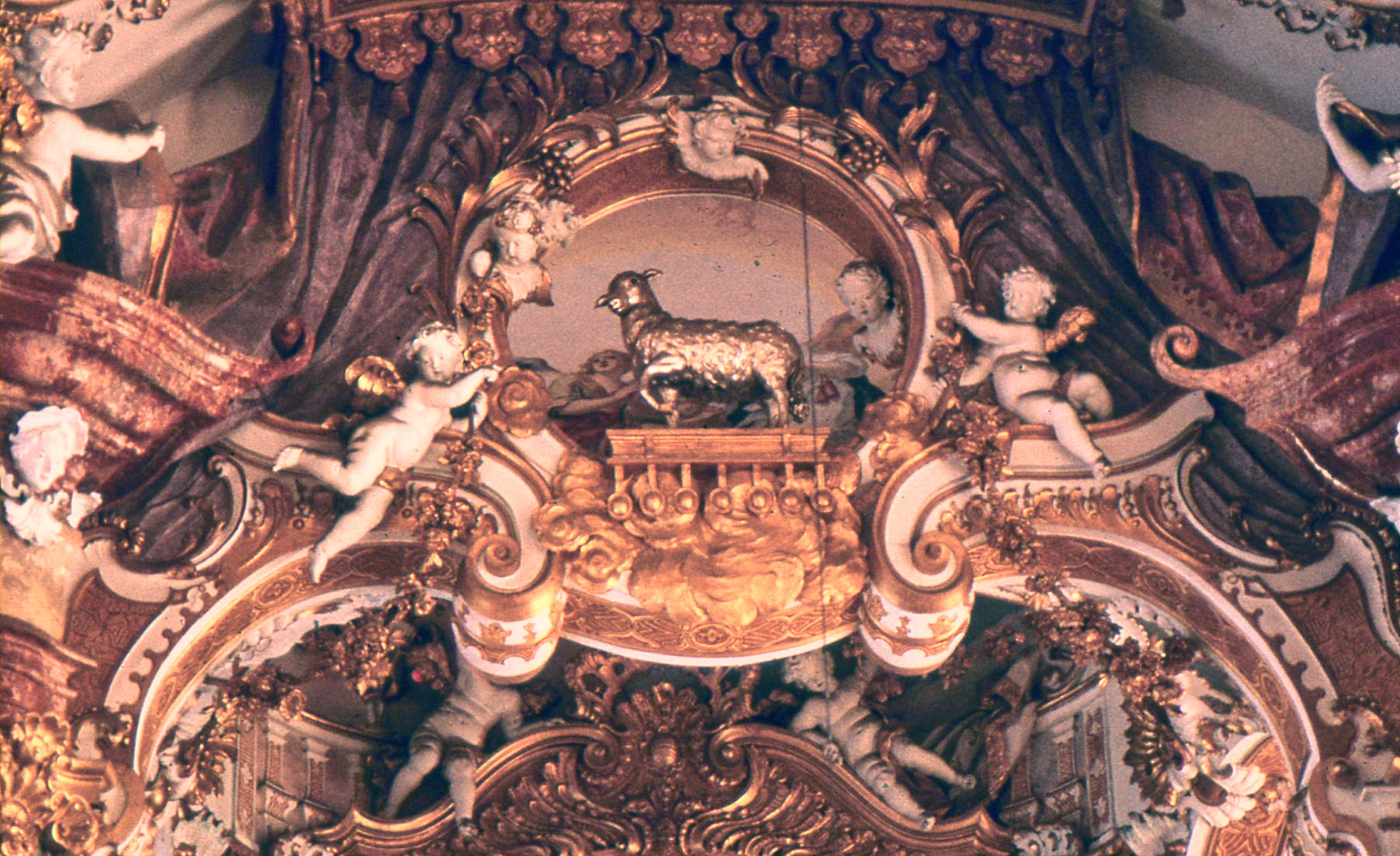 The lamb of God stands over all (above the altar).