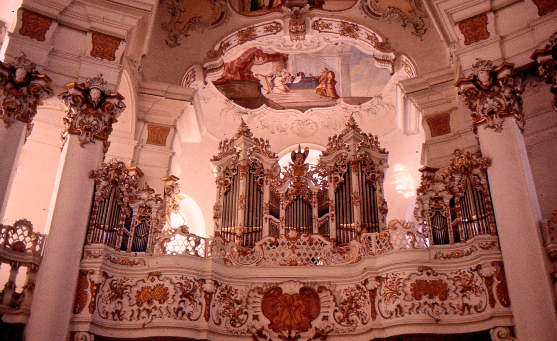Delicate tracery based on leaves and plants graces the organ and loft.