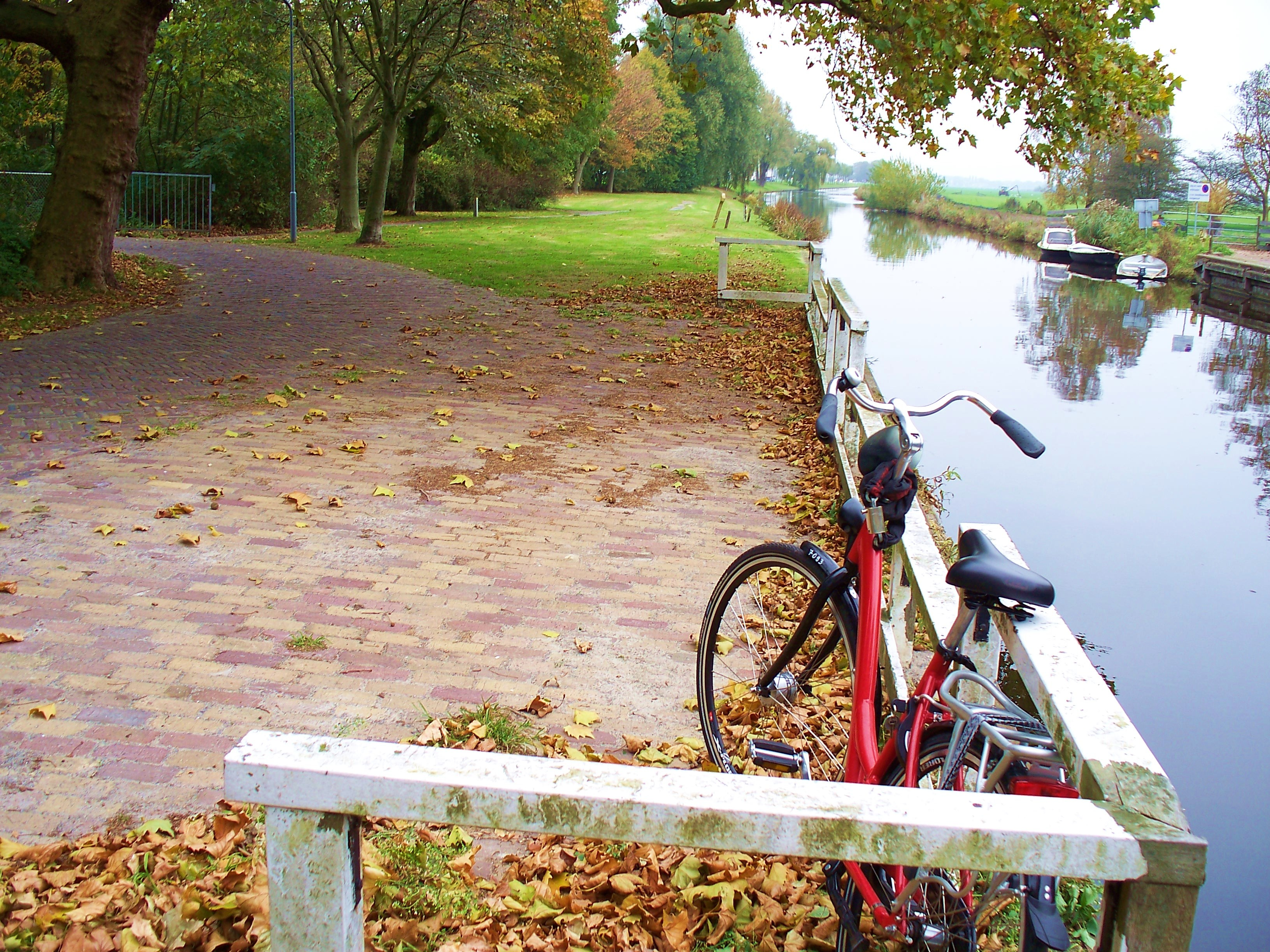 A boat, a canal, and a bike. Let the road stretch on forever.