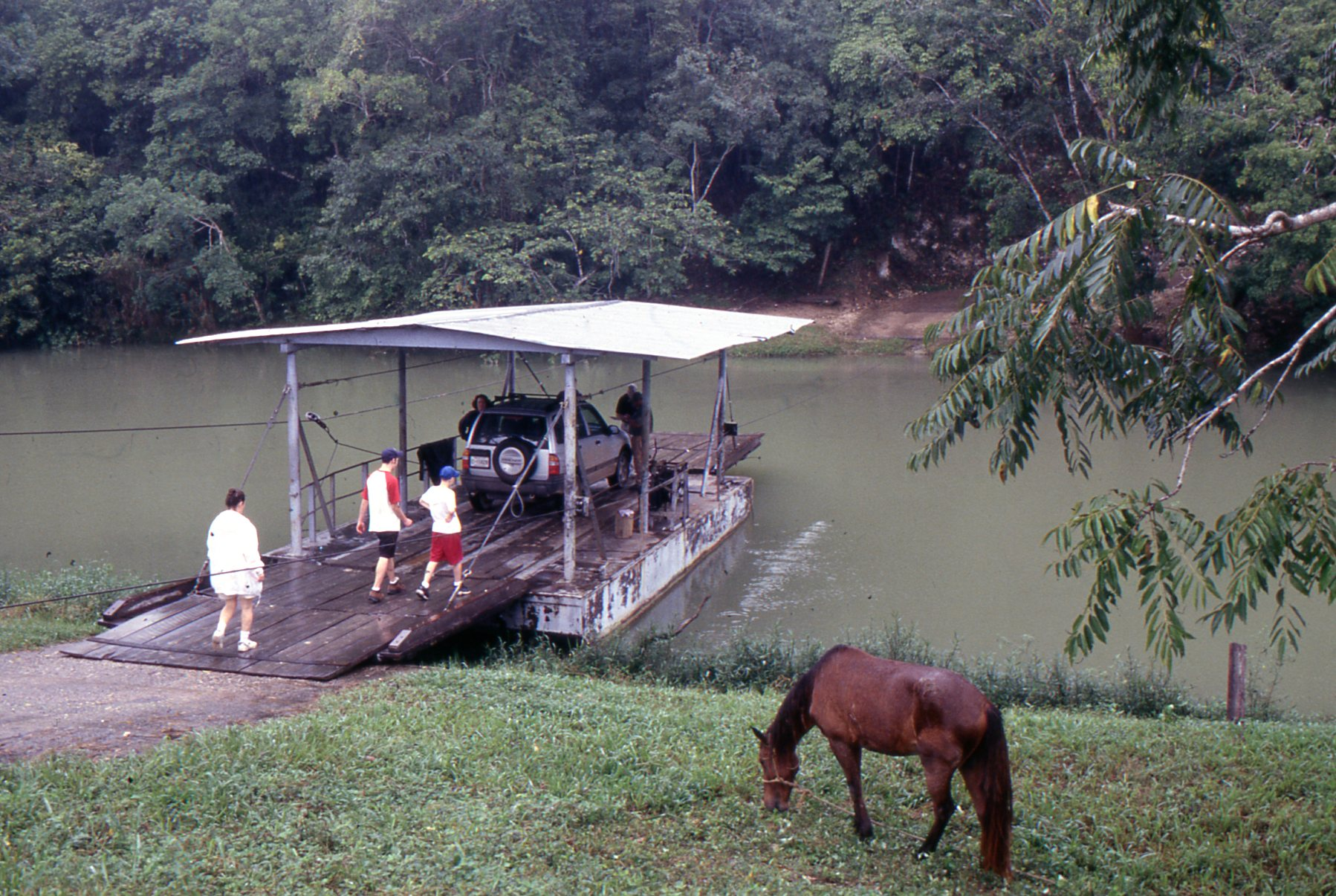A hand-cranked ferry across the Mopan River leads to the ruins of Xunantunich.